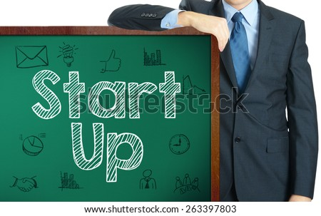 Start Up on blackboard presenting by businessman - stock photo