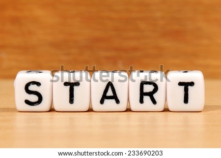 start word concept on white cube - stock photo