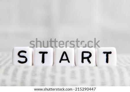 Start word on white cube - stock photo
