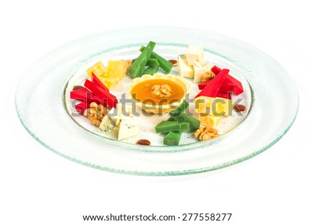 starter platter with appetizers.Tartlet and assorted fruits and nuts - stock photo