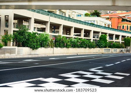 Starting grid and pit lane asphalt on Monaco Montecarlo race Grand Prix street circuit - stock photo