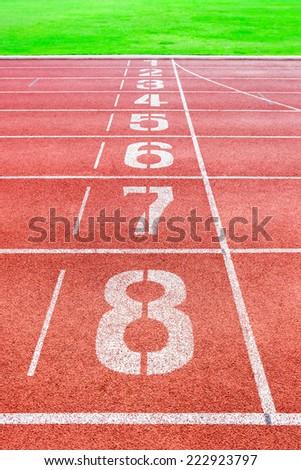 Starting Line of Track Running Lanes in sport stadium - stock photo