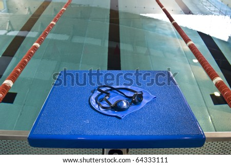 starting platform swimming pool lying cap and swimming goggles - stock photo