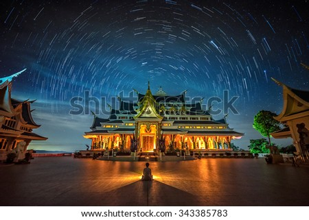 Startrail with Bright Stars and space dust at wat pa phu kon temple, Udon Thani Thailand   - stock photo