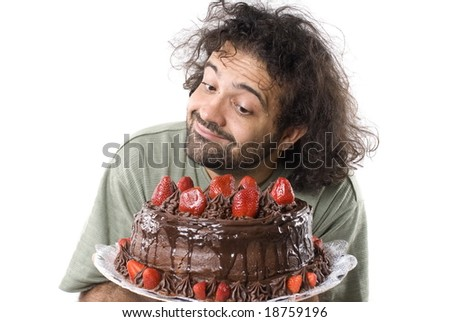 Starving Man looking at the tasty cake . - stock photo