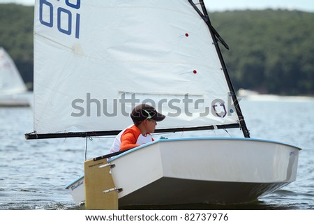 STARY SALTOV,UA - AUGUST 6: Class Optimist sailing boats unidentified participants compete during Slobozhanshina Sailing Cup. August 6, 2011 in Stary Saltov, Ukraine - stock photo