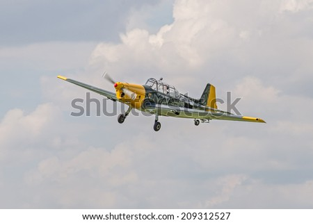 STARY TEKOV, SLOVAKIA - JULY 26, 2014: Historic German bomber Zlin 205 approaching the battlefield during reenactment of World War II fights - stock photo
