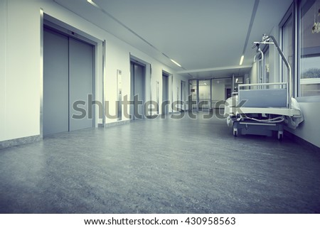 state of emergency empty bed in the corridor of the emergency room and outpatient hospital - stock photo