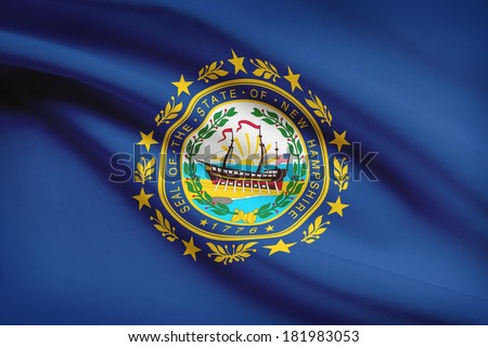 State of New Hampshire flag blowing in the wind. Part of a series. - stock photo