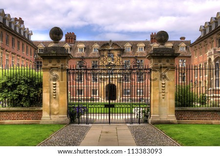 Stately home and gate Exterior of historic stately home with closed metal gate in foreground. - stock photo