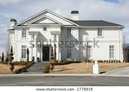 Stately white mansion on a hill - stock photo
