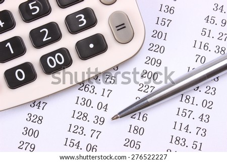 Statement of account with pen and calculator - stock photo