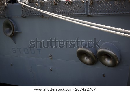 STATEN ISLAND, NY - MAY 24 2015: Lines securing the stern of the stern of the guided-missile destroyer USS Stout (DDG 55) moored at Sullivans Pier during Fleet Week NY 2015. - stock photo
