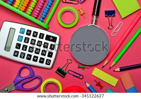 Stationary office tool on pink background - stock photo