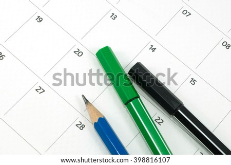 stationery on calendar date - stock photo