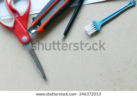 Stationery.School and office supplies frame on Plywood background - stock photo