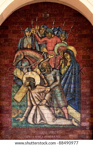 Stations of the Cross: Jesus falls the first time; A panel of Portuguese tiles outside the shrine of Fatima - stock photo