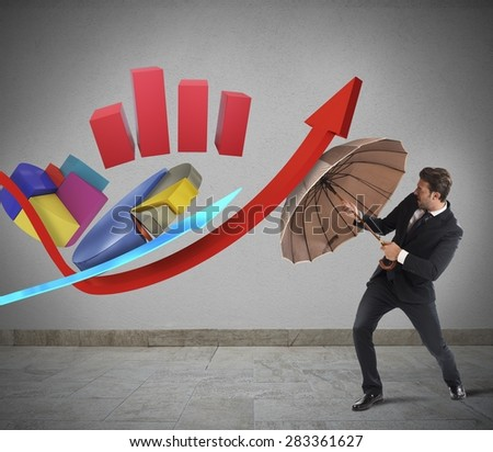 Statistic challenge of a businessman with umbrella - stock photo