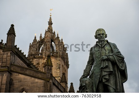 Statue and church in Edinburgh, Scotland - stock photo