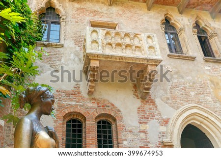Statue and Juliet's balcony in Verona. The main tourist attraction. - stock photo