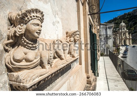 statue and panorama in Scicli, Sicily, Italy, Europe - stock photo