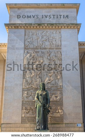 Statue at the entrance of the court of Porto. - stock photo