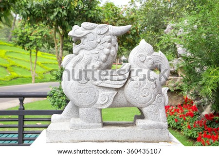 statue china lion garden guardian front of place in china traditional - stock photo