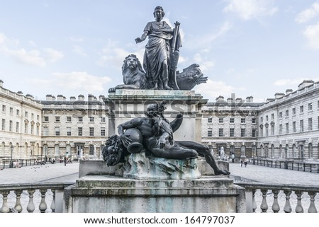 Statue George III with the River god (1789). Somerset House - large Neoclassical building (design Sir William Chambers, 1776) in central London. Somerset House - one of major culture center in London. - stock photo