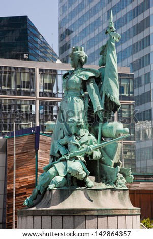 Statue in La Defense, the financial district in Paris, France. - stock photo