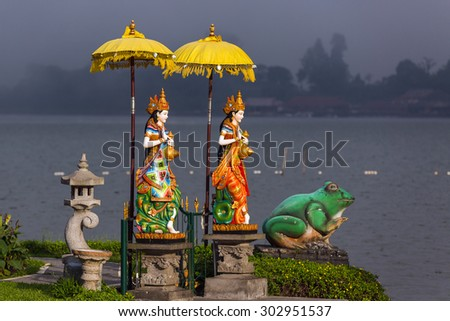 Statue in Pura Ulun Danu temple on a lake Beratan (Bratan). Bali - stock photo
