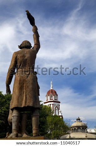 Statue Miguel Hidalgo Public Park with Churches, Tlaquepaque, Guadalajara, Mexico.  Father Hidalgo was one of the heroes of the Mexican War of Independence. - stock photo