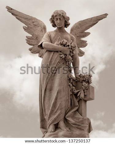 Statue of a marble angel in sepia tone - stock photo