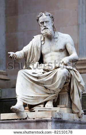 Statue of a philosopher in the ancient Greek style, situated in front of the building of Austrian Parliament. - stock photo