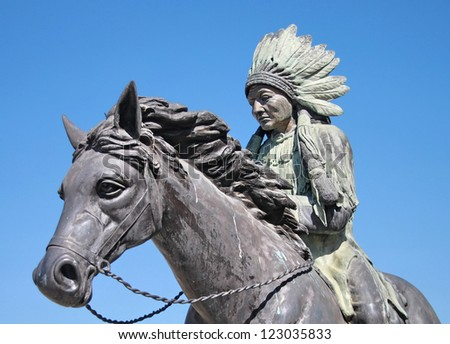 Statue of A Red indian or native American that riding a horse - stock photo