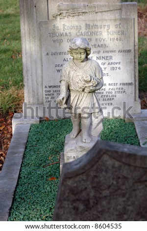 statue of a stone cherubim / angel in a cemetery in london, england - stock photo