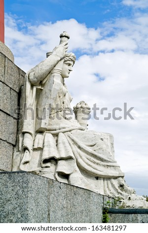 Statue of allegory of the river Neva at the rostral column. 1810 year  - stock photo