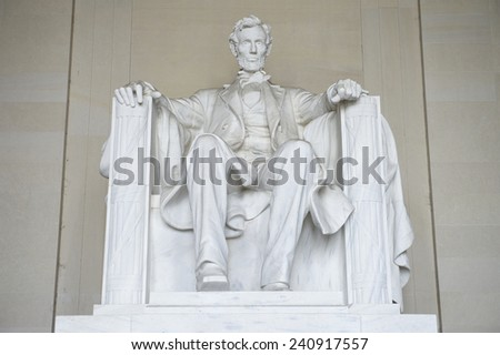 Statue of American president Abraham Lincoln seated in white marble at Lincoln Memorial Washington DC USA  - stock photo