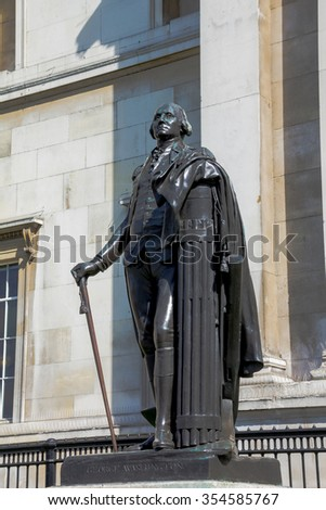 Statue of American president George Washington near  National Gallery  on  Trafalgar Square in London. The bronze statue is a replica of Jean Antoine Houdon's marble statue in Richmond, Virginia - stock photo