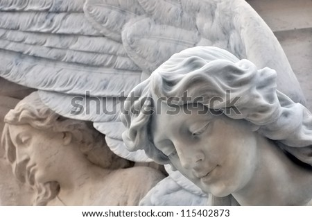 Statue of an angel at the Cemetery - stock photo