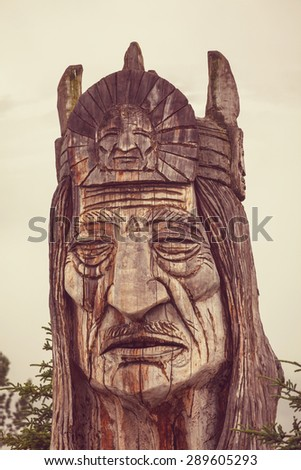 statue of an indian head totem - stock photo