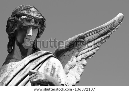 statue of angel with one wing - stock photo