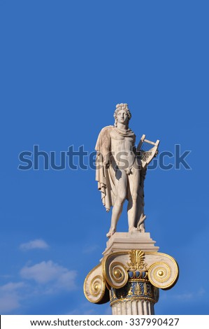 Statue of Apollo on top of a pillar in front Academy of Athens, Greece  - stock photo