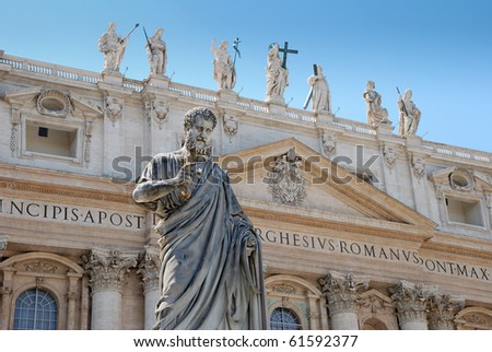 Statue of apostle Peter in front of facade of Saint Peter's Basilica in Vatican, Italy. - stock photo