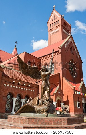 Statue of Archangel Michael and the Catholic Church of St. Simon and St. Helena on Independence Square in Minsk, Belarus. - stock photo