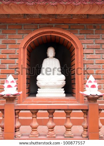 Statue of Buddha at Tran Quoc Pagoda in Hanoi, Vietnam - stock photo