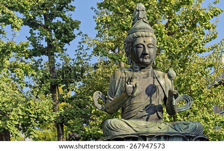 Statue of Buddha (Bohdisattva Avalokiteshvara) in the popular Buddhist Asakusa Kannon temple in Tokyo, Japan - stock photo