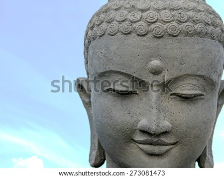 statue of buddha, close up of the face - stock photo