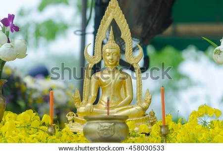 Statue of Buddha on nature background .selective focus. - stock photo
