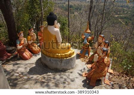 Statue of Buddha preaching to his disciples,  Sambuk Mountain Monastery, Kratie,  Cambodia - stock photo