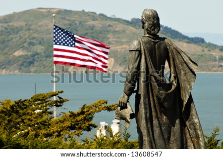 Statue of Christopher Columbus and USA flag in San Francisco - stock photo